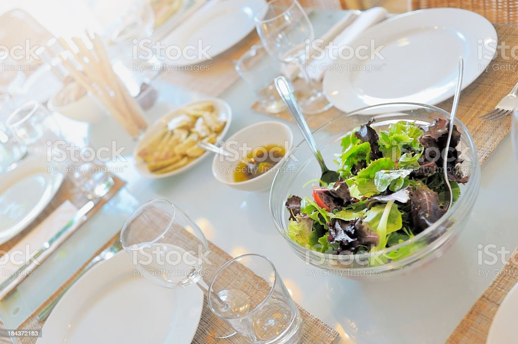 Simple Dinner Party table with Mixed Salad royalty-free stock photo