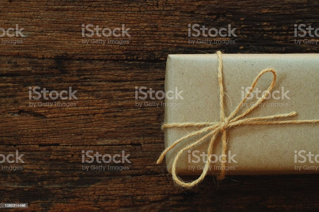 Simple eco friendly gift boxes package wrap with brown paper in old...