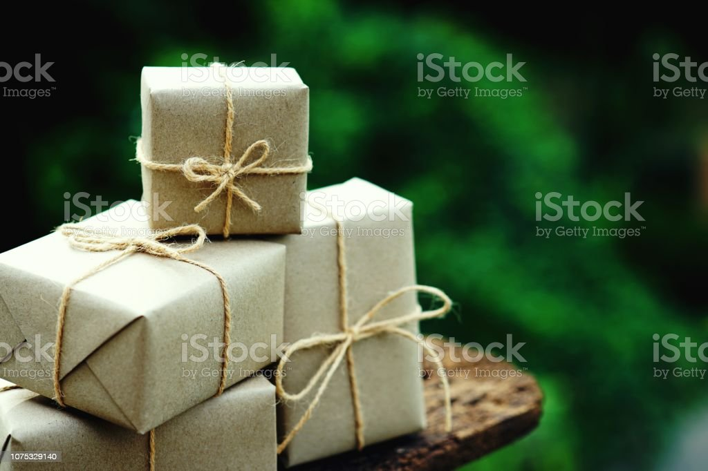 Simple eco friendly gift boxes package wrap with brown paper on...