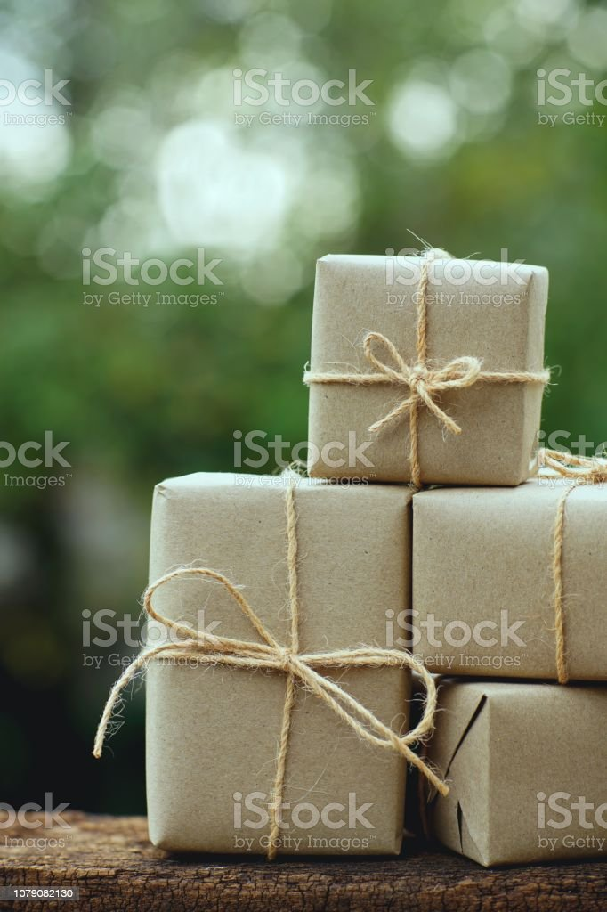 Simple eco friendly gift boxes package wrap with brown paper with...