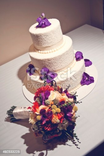 Simple elegant wedding cake with purple flowers boquet stock photo simple elegant wedding cake with purple flowers boquet stock photo more pictures of baked istock mightylinksfo