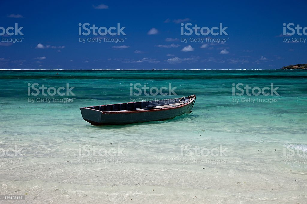 Simple fisherboat at Mauritius beach royalty-free stock photo
