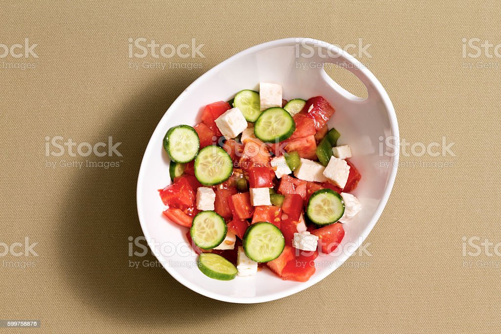 Simple fresh salad with feta cheese stock photo