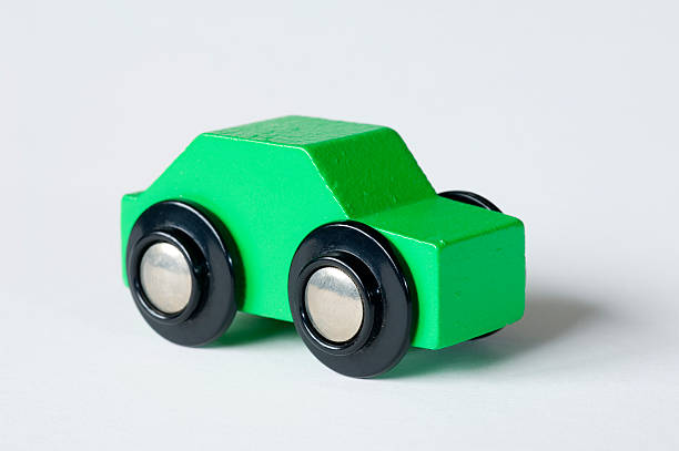 Simple green toy car stock photo