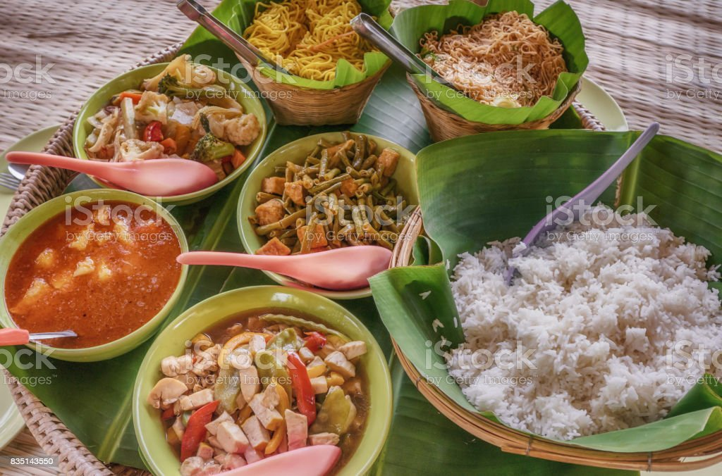 Simple home-cooked traditional everyday Thai food served in banana leaves and baskets. stock photo