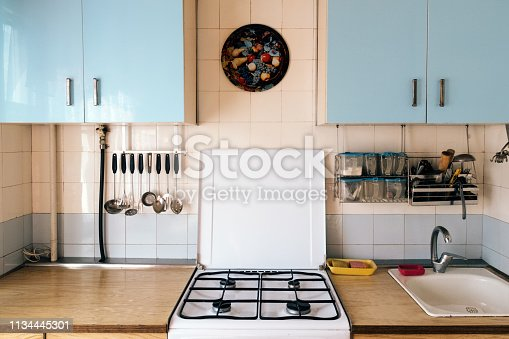 istock Simple kitchen interior with shabby wall cabinets in old house 1134445301