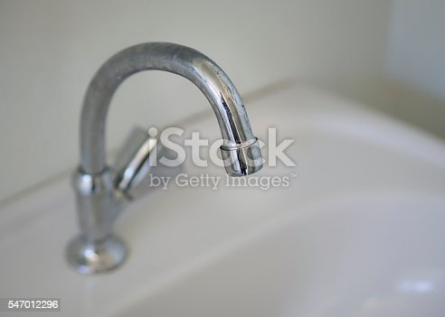 istock Simple lavatory with chromed faucet 547012296