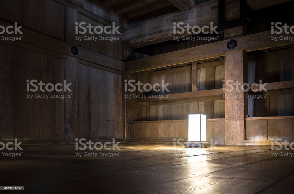 Simple light in an old wooden room stock photo