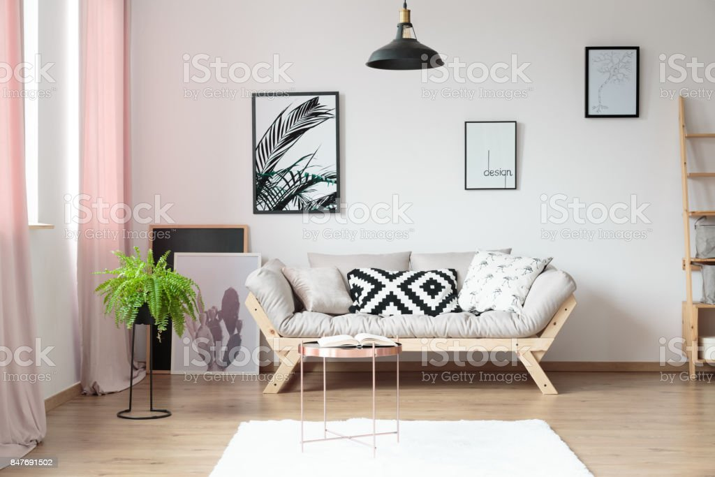 Simple living room with fern stock photo