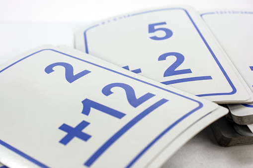 Simple math addition flash cards close-up- white background