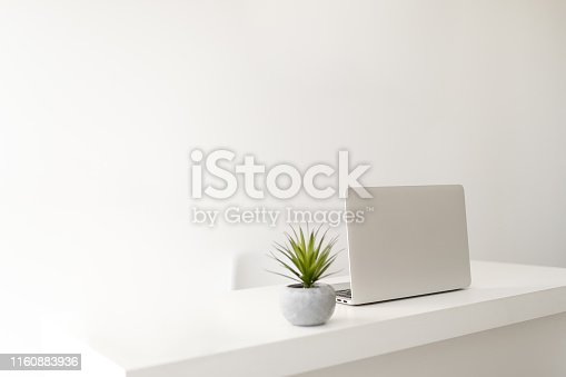 istock Simple minimalist modern office desk 1160883936