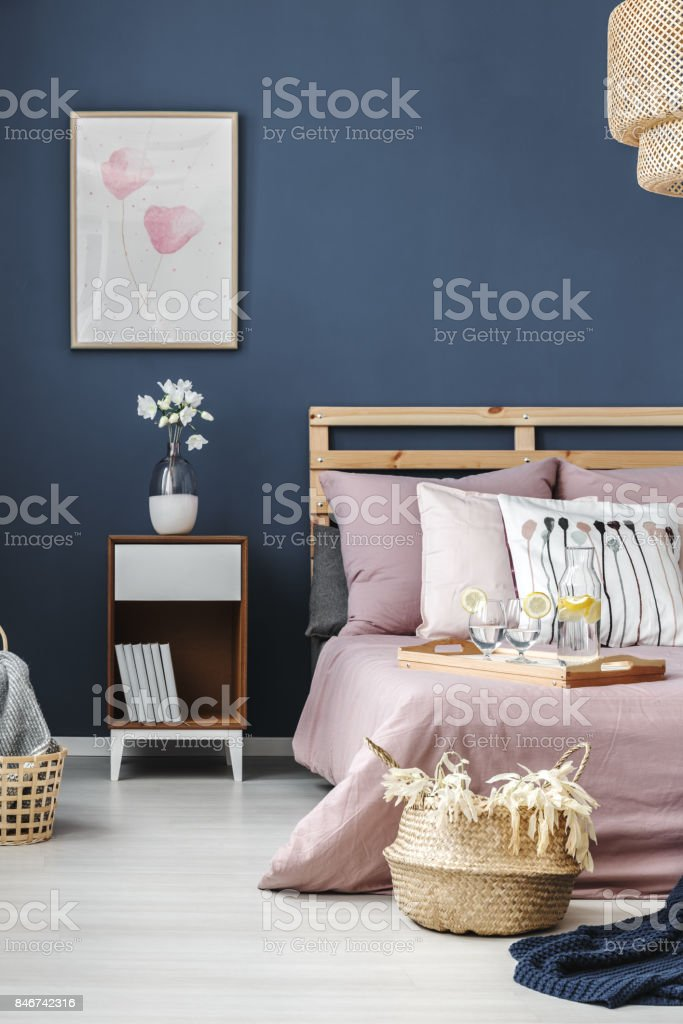 Simple painting on blue wall stock photo
