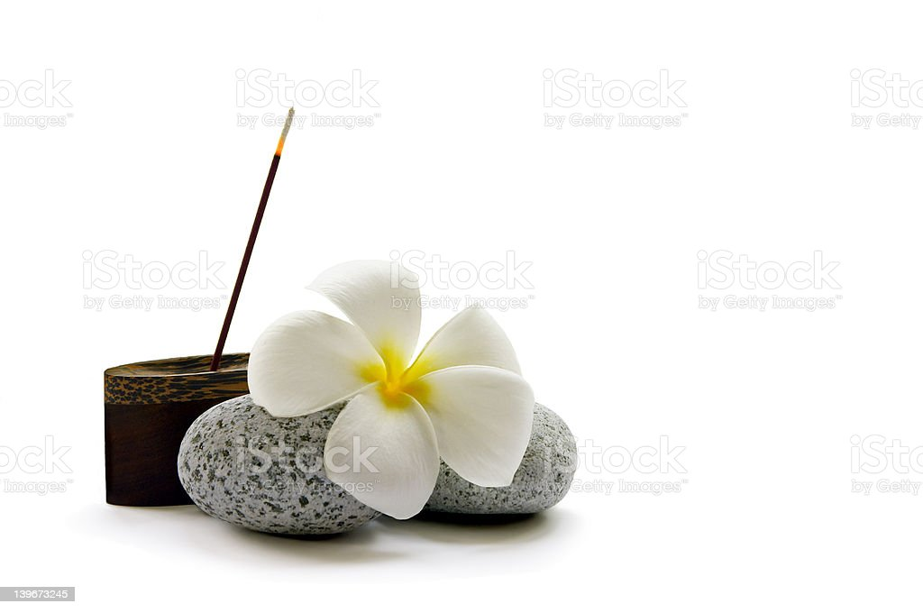 Simple Relaxation A stick of fragrant Japanese incense, some smooth pebbles and a frangipani flower Aromatherapy Stock Photo