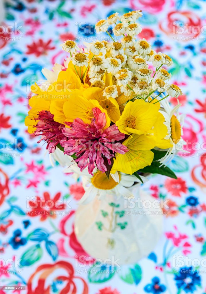 A simple, rustic, unpretentious flower bouquet in a porcelain vase...