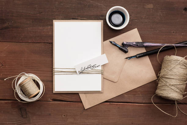 Simple rustic wedding invite, blank. Top down view. calligraphy stock pictures, royalty-free photos & images