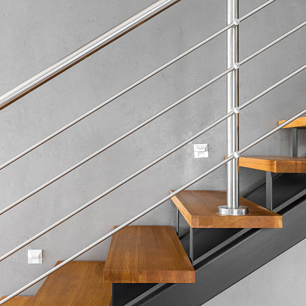 Simple staircase with chromed railing stock photo