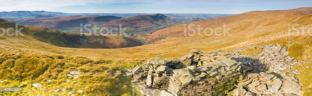 Simple stone shelter overlooking valley royalty-free stock photo