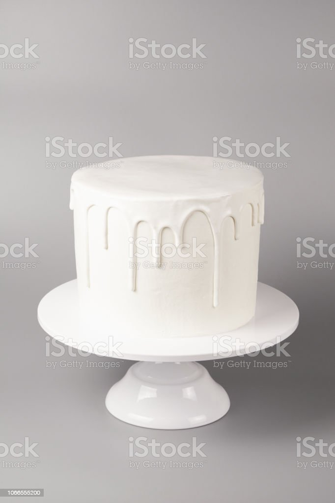 Stupendous Simple White Cake With Glaze On A Gray Background Stock Photo Funny Birthday Cards Online Aeocydamsfinfo