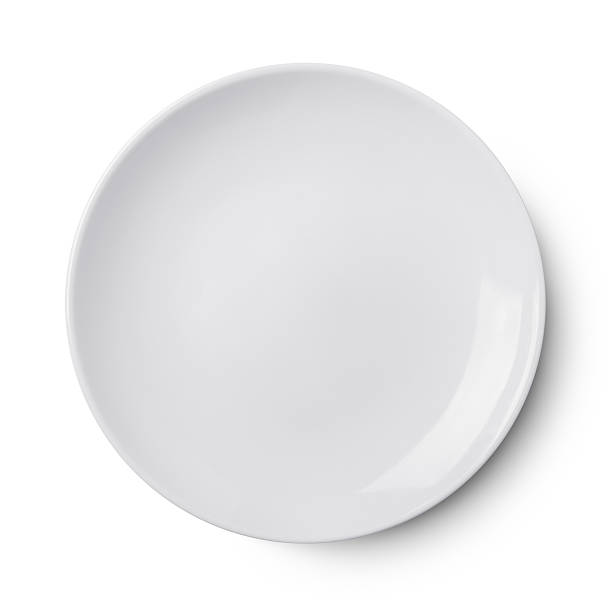 simple white circular porcelain plate - plate stock pictures, royalty-free photos & images