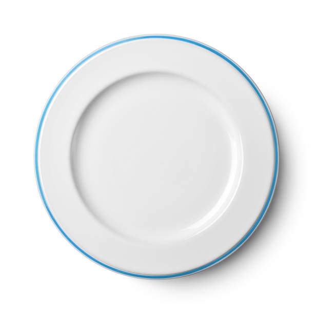 Simple white circular porcelain plate with clipping path - foto stock