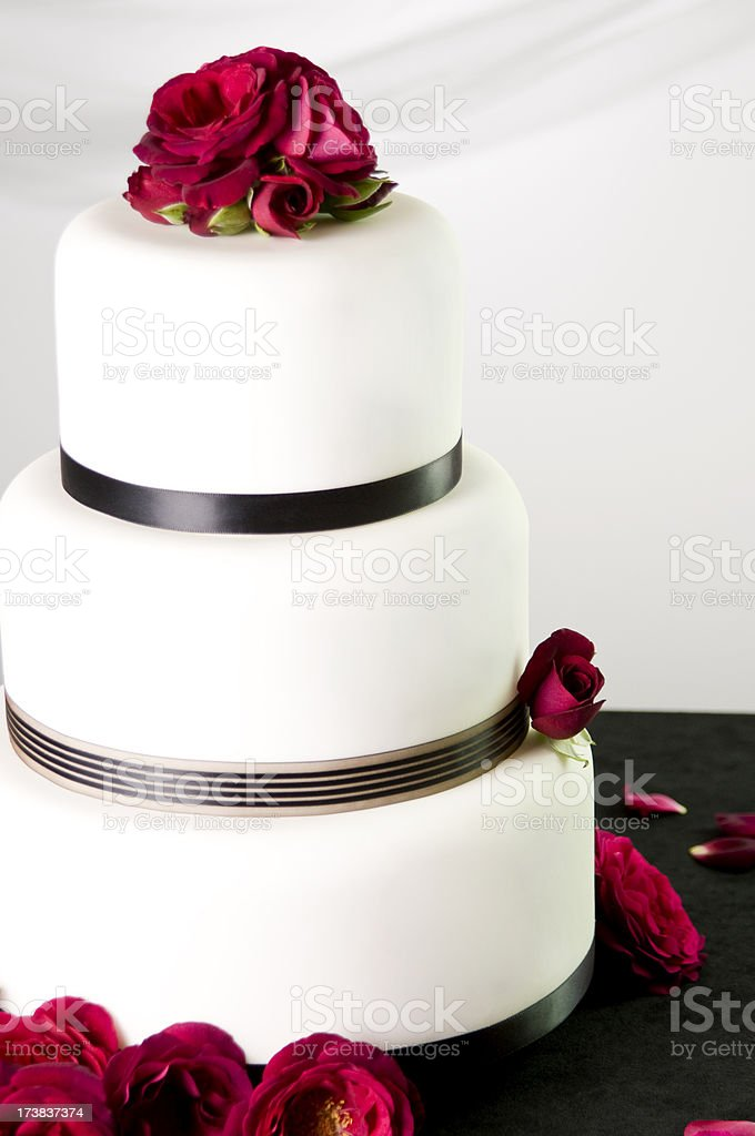 Simple White Wedding Cake With A Red Flower Topper Stock Photo