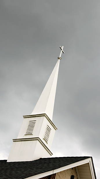 Simple Wooden Church Steeple in Stormy Sky stock photo