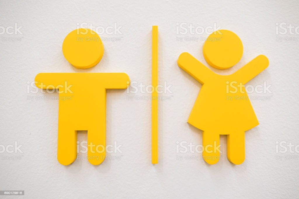 Simple yellow  male and female symbols stock photo