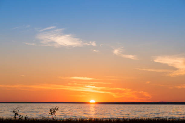 Simplistic sunset over a body of water stock photo