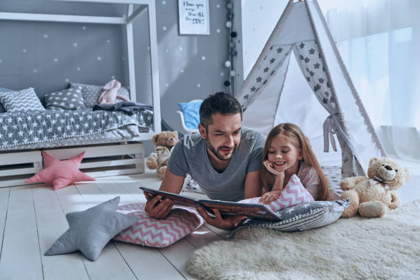 simply being around. - family room stock photos and pictures