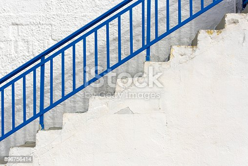 istock Simply exterior with blue staircase and stone white wall in Greece 896756414