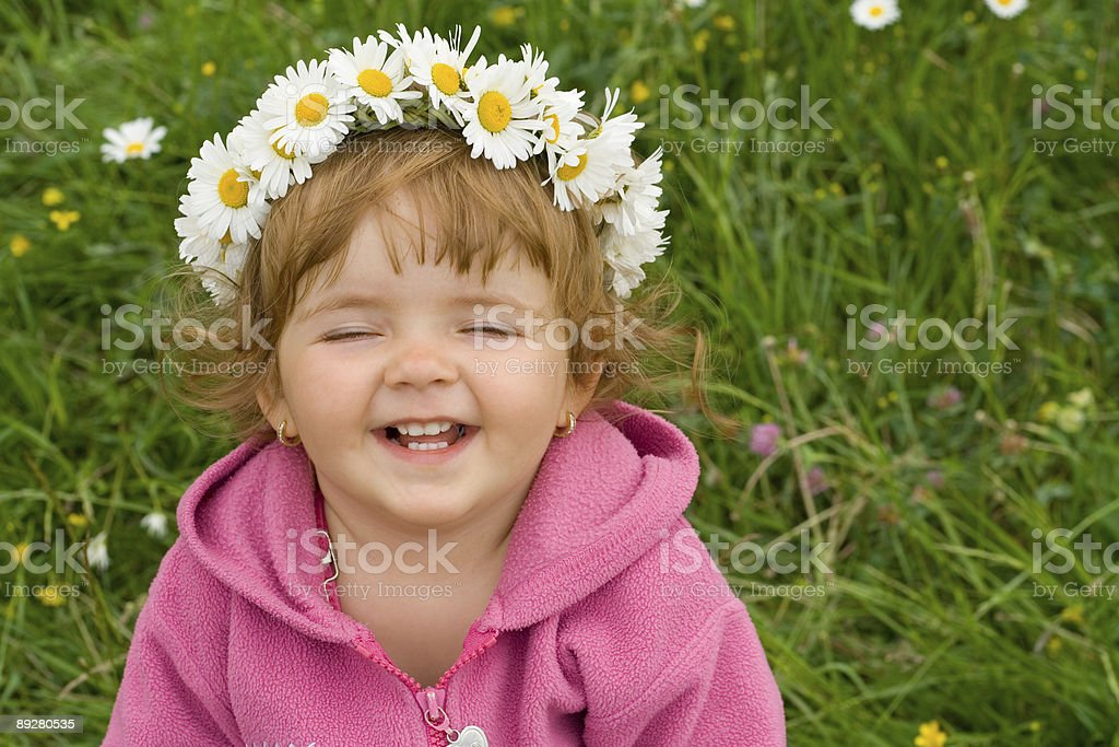 Simply happy girl with daisy wreath royalty-free stock photo
