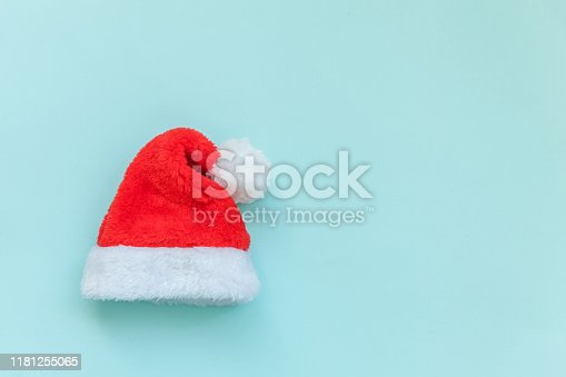 istock Simply minimal design Christmas Santa Claus hat isolated on blue pastel colorful trendy background 1181255065