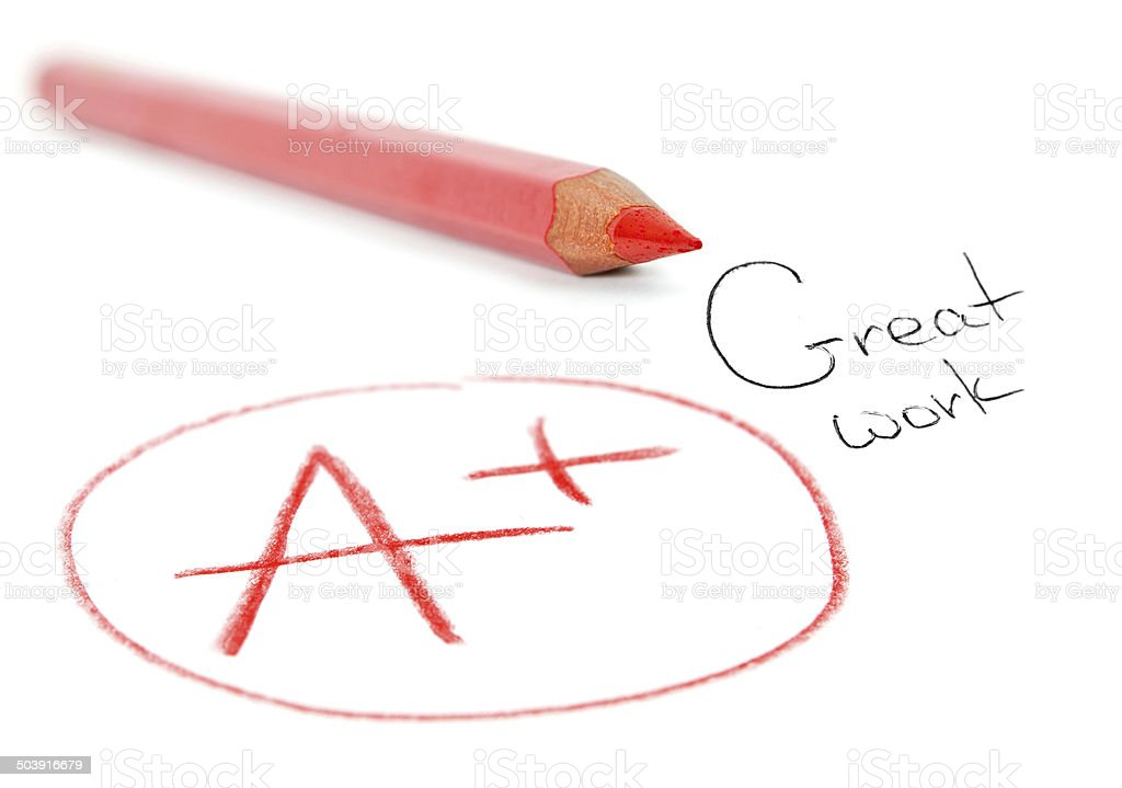 A+, simply the best. A paper is graded A Plus stock photo