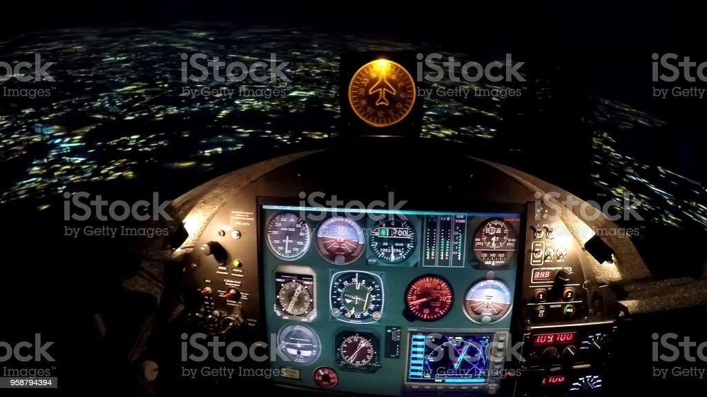 Simulator control panel of flight above night city, airplane steering wheel stock photo