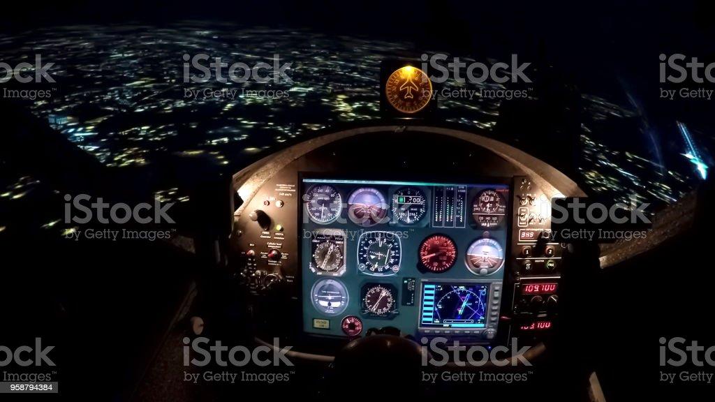Simulator of night flight above city, training equipment for beginner pilots stock photo