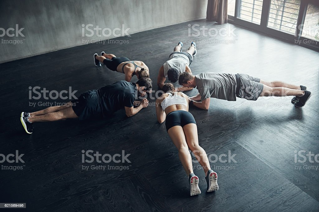 Simultaneously pushing each other to go harder foto stock royalty-free