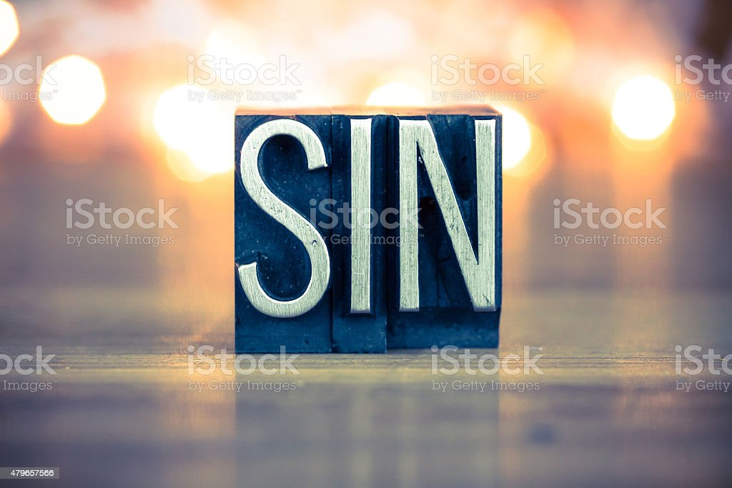 Sin Concept Metal Letterpress Type stock photo
