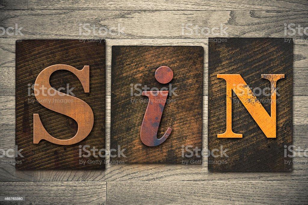 Sin Concept Wooden Letterpress Type stock photo