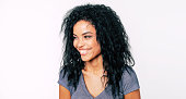 istock Sincerity. Close-up photo of alluring tanned woman with Afro hairstyle smiling broadly and looking to the left. 1180642009