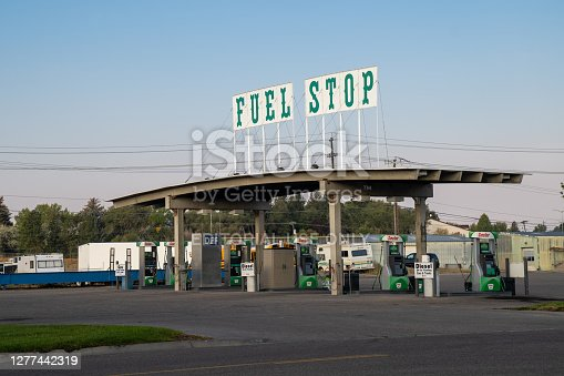 Idaho Falls, Idaho - September 22, 2020: A Sinclair gas station called Fuel Stop with an interesting vintage sign on top of the roof
