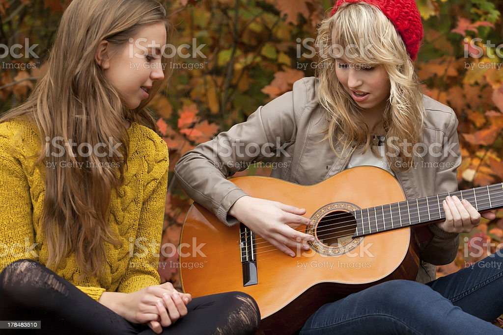Sing a song with the guitar stock photo