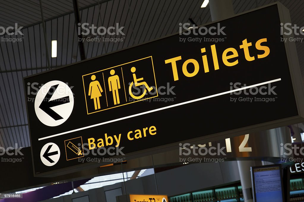 Sing board at airport - to Toilets & Baby care royalty-free stock photo