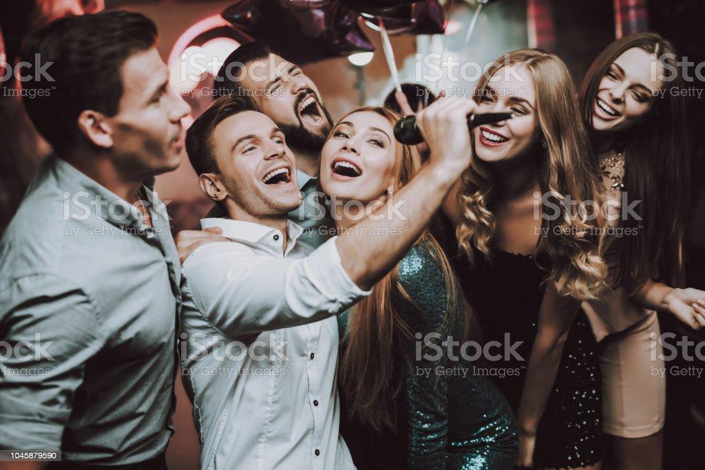 Sing. Men. Dance Club. White Shirt. Young People. stock photo