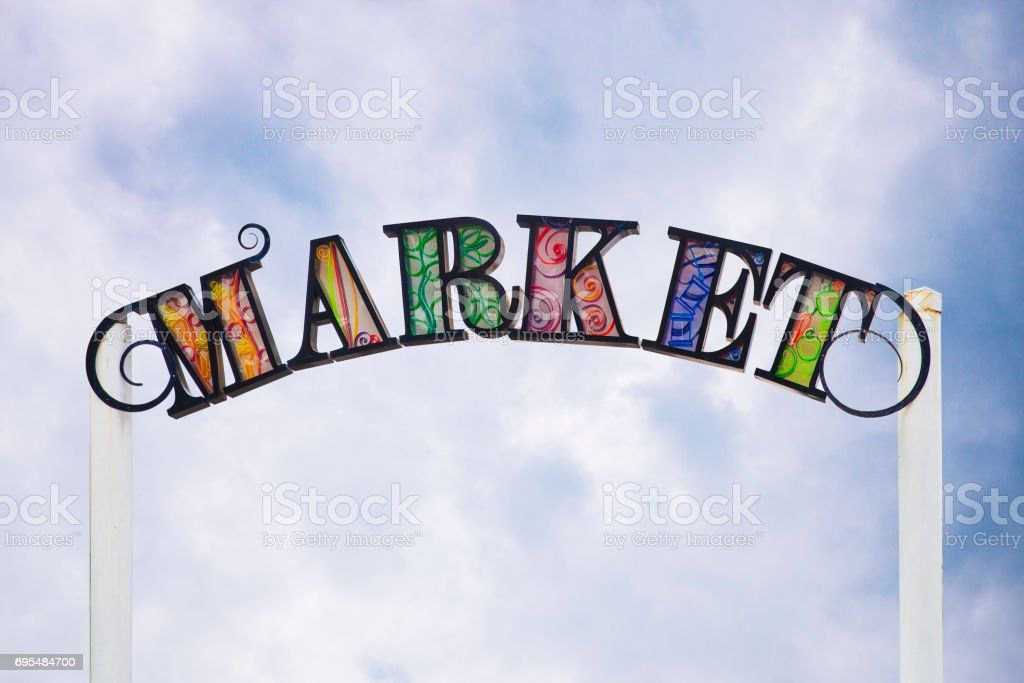 Sing of a street market with sky background stock photo