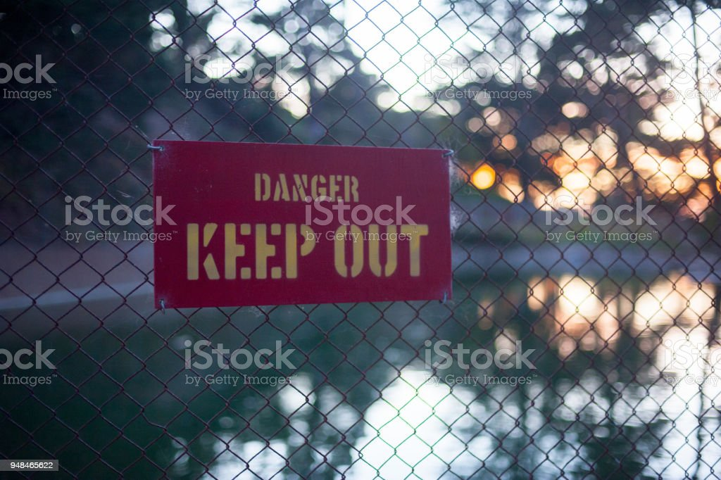Sing says DANGE KEEP OUT on the park of Long Beach, California stock photo