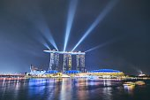 Singapore - September 7, 2018: Night view of The ArtScience Museum (left) and Marina Bay Sands Hotel in downtown of Singapore on September 7, 2018.