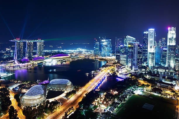 Singapore at Night Aerial view of Marina Bay with CBD, Singapore at night. esplanade theater stock pictures, royalty-free photos & images