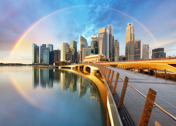Singapore business district with rainbow stock photo