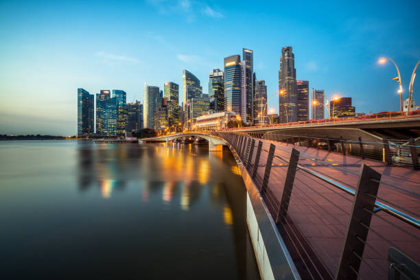 singapore central business district skyline at blue hour - singapore stock photos and pictures