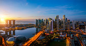 istock Singapore city and sunrise sky in harbour side view 1161733650